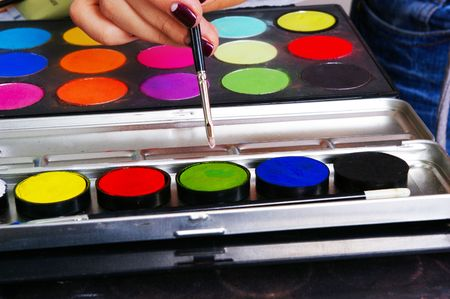 grease paint: Palette of a grease paint on the makeup artists workplace