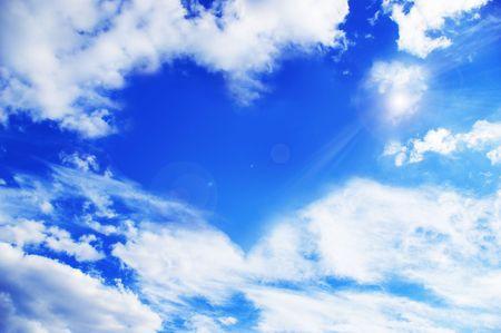 White clouds making a heart shape againt a blue sky