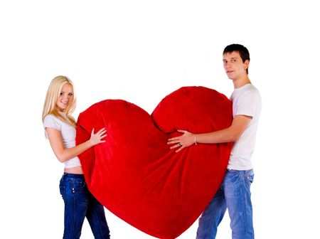 adult dating: Young couple with a big heart on white background Stock Photo