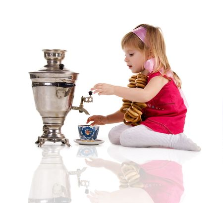 Pretty little girl near the samovar on white background Stock Photo - 6221602