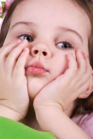 Cute sad little girl close-up. Studio shot photo