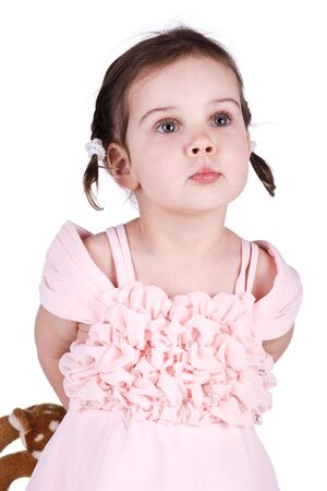 conceal: Little girl in pink dress conceal her toy. White background Stock Photo