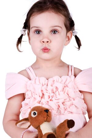 Little girl with her toy on white background photo