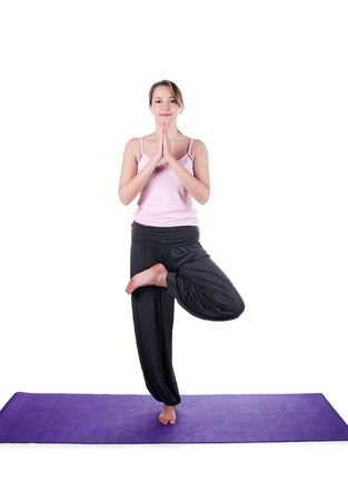 Woman is engaged in yoga on a white background photo