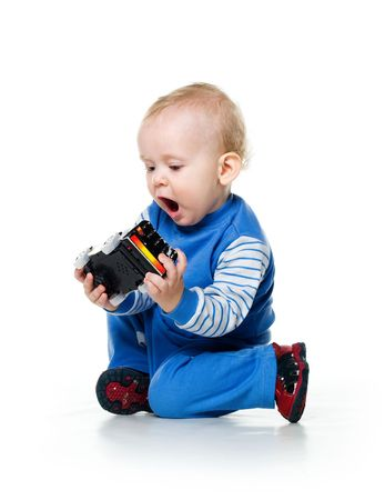 Cute little boy with the car toy on white background photo