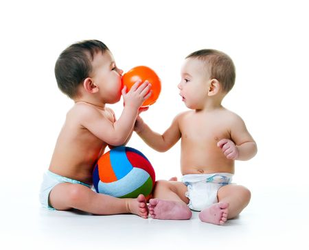 head toy: Twin brothers with balls isolated on a white background