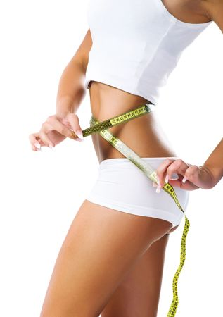 Woman measuring perfect shape of beautiful waist. Healthy lifestyles concept Stock Photo - 6657225