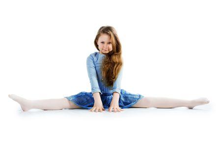 little girl dancing: Little ballet dancer isolated on a white background