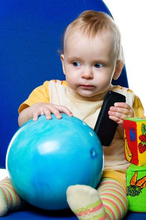Little boy with a ball on white background photo