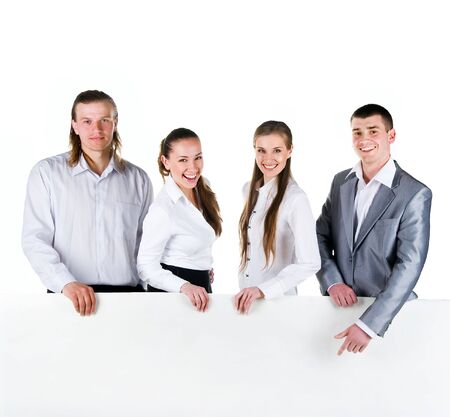 Business team holding a large blank sign on white background photo