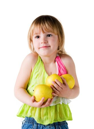 armful: Little girl with armful of apples isolated on white background