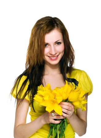 Pretty women with yellow flowers on white photo