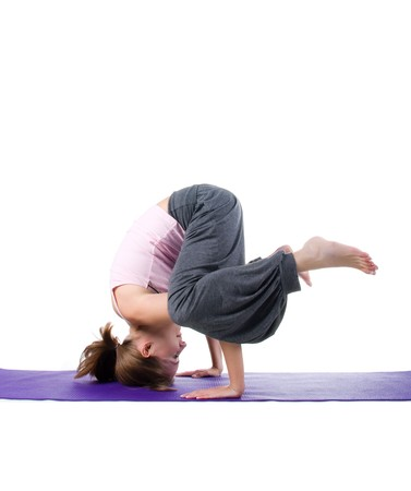 Women is engaged in yoga on a white background photo