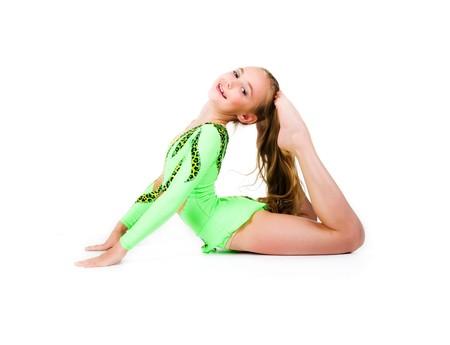 turnanzug: Wenig Ballett-T�nzerin, die isoliert auf wei�em Hintergrund  Lizenzfreie Bilder