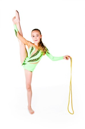 Little gymnast with the skipping rope on white background photo