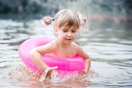 Little wet girl with air buoy Stock Photo - 7301120