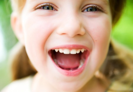 close up: Portrait of a happy liitle girl close-up
