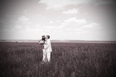 just married couple on the field. black-and-white photo photo