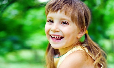 little girl smiling: Portrait of a happy liitle girl close-up
