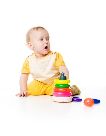 Little boy with a pyramid on white background photo