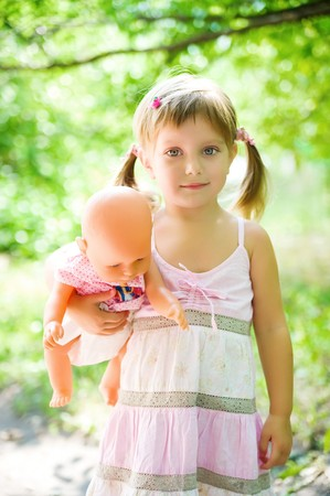 Cute little girl with her doll