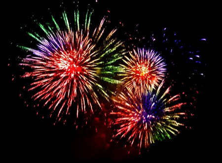 holiday display: colourful fireworks explosion on a black background