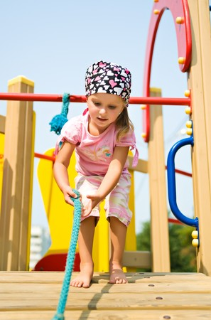 jungle gyms: Pretty little girl on outdoor playground equipment  Stock Photo