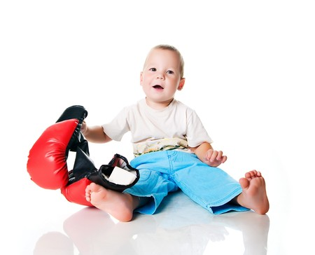 Cute little boy with the boxing gloves Stock Photo - 7648524