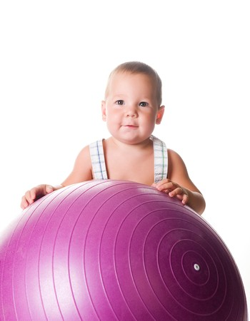 Little boy with the fitness ball on white background  photo