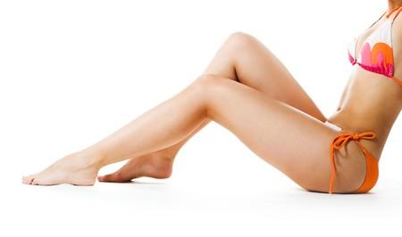 Perfect female legs isolated on white background photo