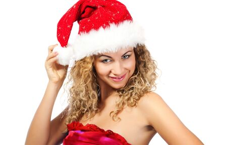 attractive young women in santa claus hat photo