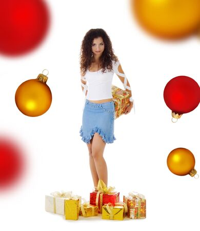 Pretty woman with a christmas gifts. Studio isolated on a spheres background photo