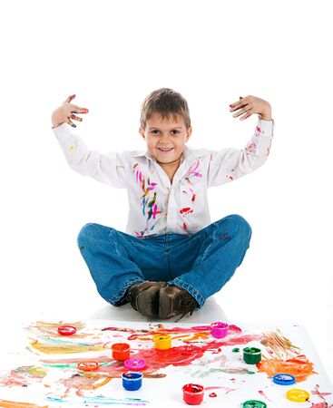 3 year old boy: Adorable 3 year old boy covered in bright paint.