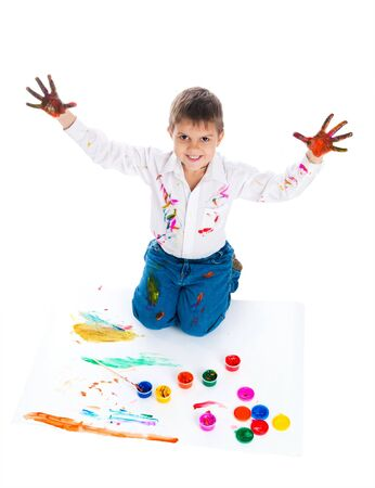 3 year old: Adorable 3 year old boy covered in bright paint.