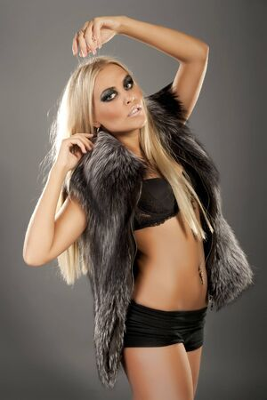 Beautiful fashion model dressed in fur photo