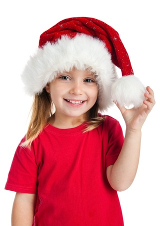 Cute little girl in the santa claus hat photo