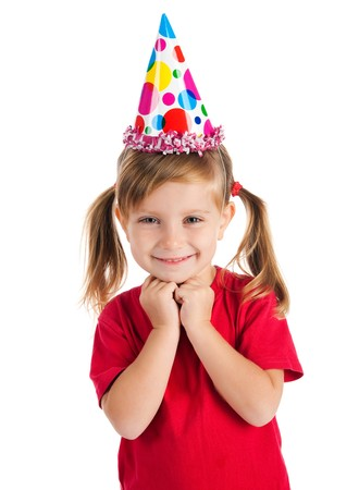 Funny girl in birthday cap isolated on white Stock Photo