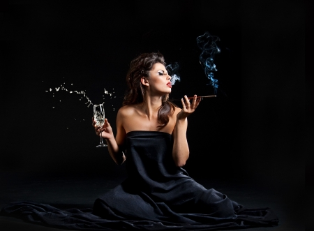 Glamour women with champagne and cigarette on black photo
