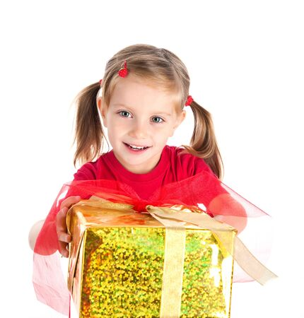 holding a christmas ornament: Four years old girl wih the present