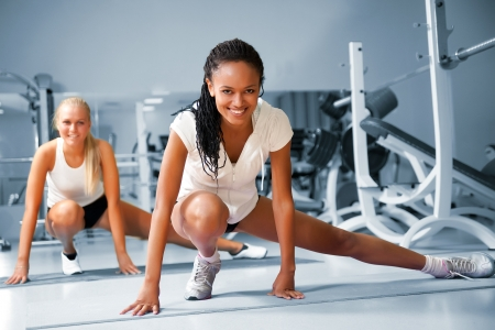 fitness instructor: Young woman doing exercises at the fitness club