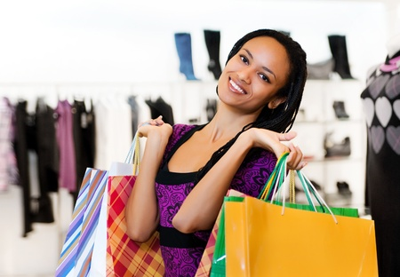 excitement: Beautiful  latin american women with packages shopping