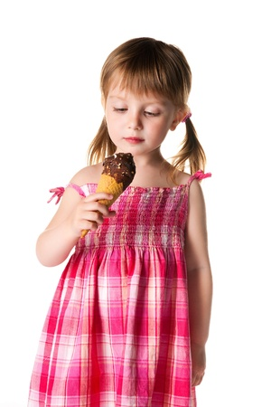 cute little girl with the ice-cream on a white background photo