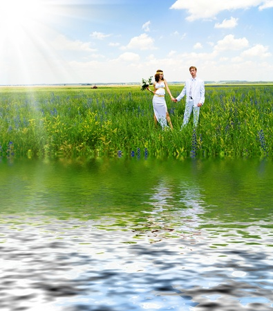 just married couple on the green field photo