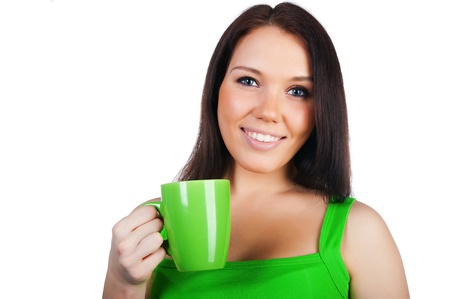 Pretty young women with the cup of tea on white photo