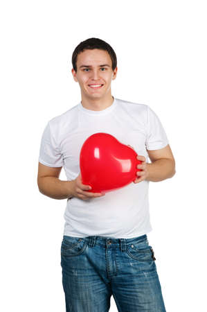 Cute young menl with a red heart over white photo