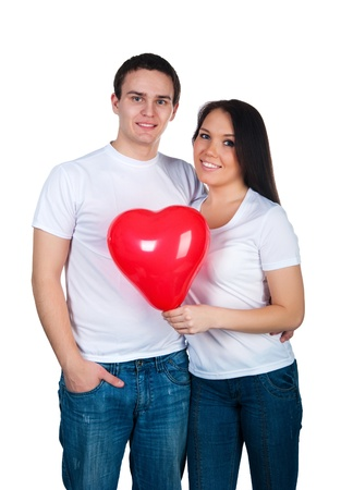 Young couple with a heart over white background photo