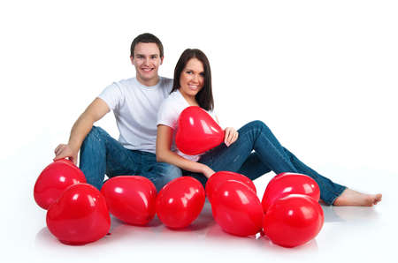 Young couple with a hearts over white background photo