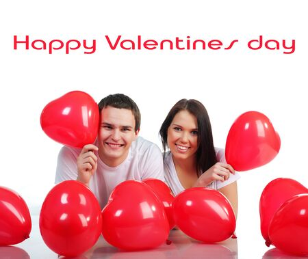 adult valentine: Young couple with a hearts over white background