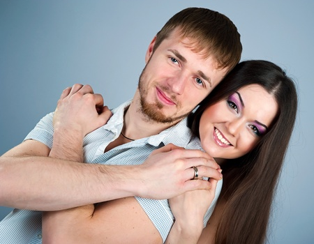 Young couple  over blue background photo