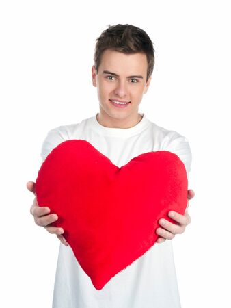 Cute young men with a red hearts over white photo
